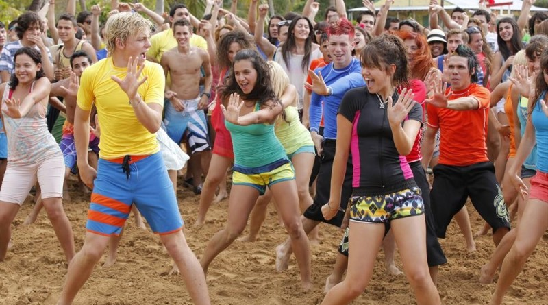 "TEEN BEACH MOVIE 2 - Disney Channel will begin production in July on ""Teen Beach Movie 2,"" the sequel to last summer's ""Teen Beach Movie,"" a Disney Channel Original Movie that ranks as cable TV's all-time #2 movie in Total Viewers.  Ross Lynch (""Austin & Ally"" and Hollywood Records' R5), Maia Mitchell (""The Fosters""), Grace Phipps (""Baby Daddy""), Garrett Clayton (""The Fosters"") and John DeLuca (""Twisted"") will reprise their starring roles as Brady, McKenzie, Lela, Tanner and Butchy, respectively. Additional casting will be announced shortly.  ""Teen Beach Movie 2"" will premiere in 2015 on Disney Channel. (DISNEY CHANNEL/Francisco Roman) ROSS LYNCH, MAIA MITCHELL"